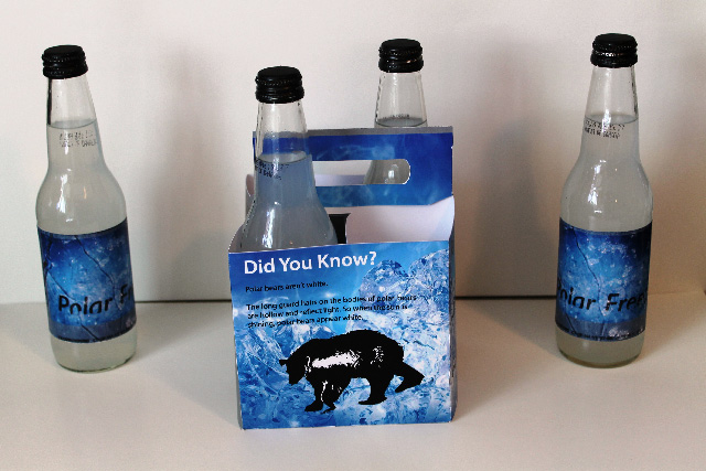 I built and designed the box as well as the labels on the bottles. I was given a theme regarding animals. I actually printed the labels, froze them in water, then photographed and reprinted them so they appeared frozen on the bottles.